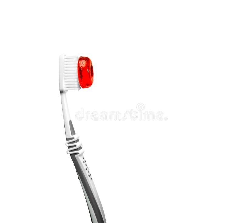 Zahnbürste mit rotem Bonbon stockfotos