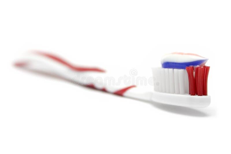 Zahnbürste mit Zahnpasta stockfoto
