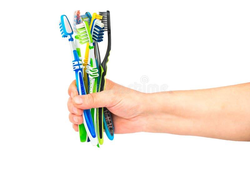 Zahnbürsten in der Hand lizenzfreies stockfoto