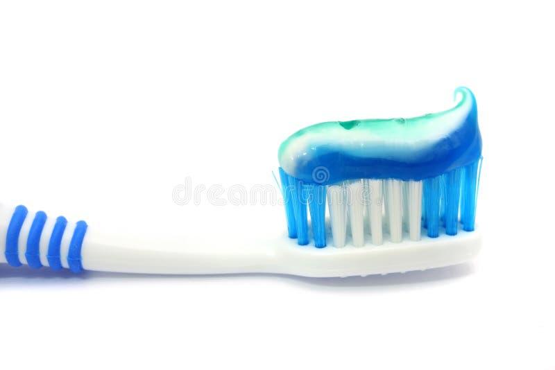 Zahnmedizinischer Pinsel mit Zahnpasta lizenzfreie stockfotografie