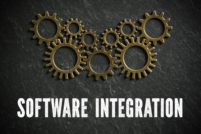 Zahnräder und das Wörter ` Software-Integration `, das ein komplexes System zusammenarbeitet symbolisiert lizenzfreie stockfotografie