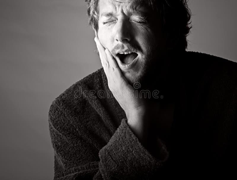 Zahnschmerzen. Autsch! stockfotografie