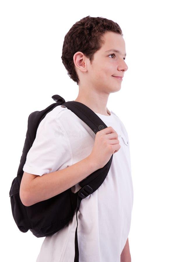 Zaino della holding dello scolaro immagini stock