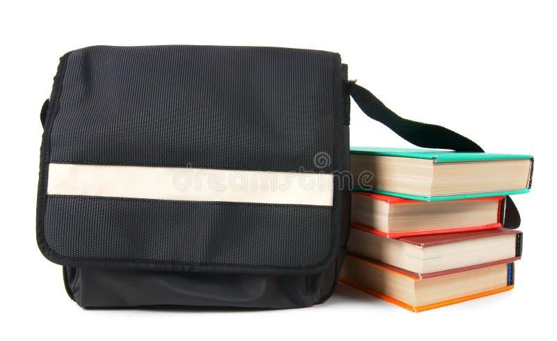 Zaino e libri del banco immagini stock libere da diritti