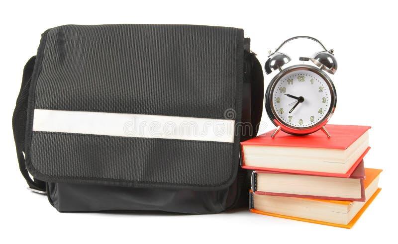 Zaino, libri e sveglia della scuola immagine stock libera da diritti