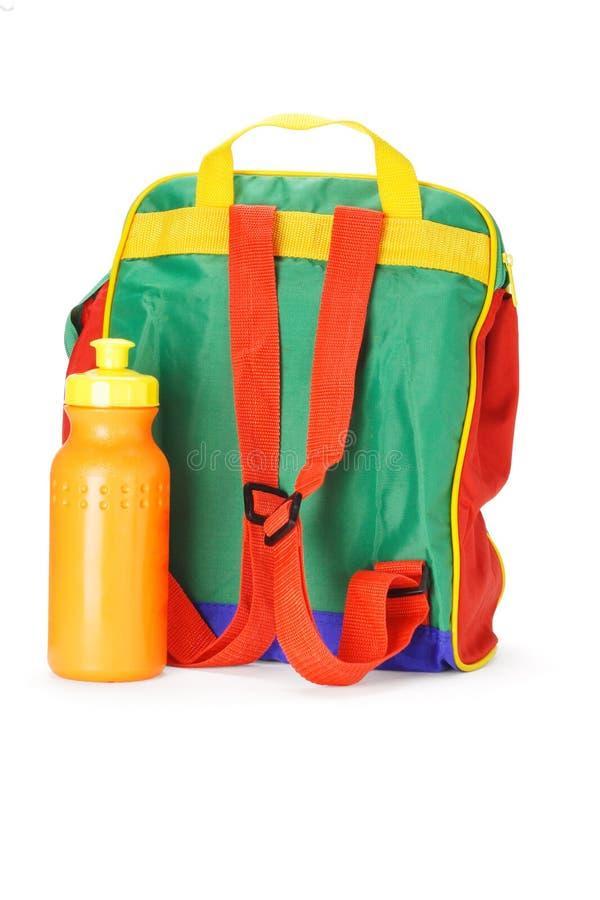Zaino variopinto del preschooler e contenitore dell'acqua immagini stock libere da diritti