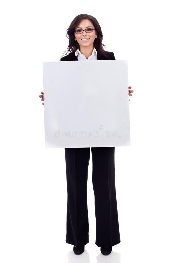 Zaken die een witte lege raad womanholding stock afbeelding