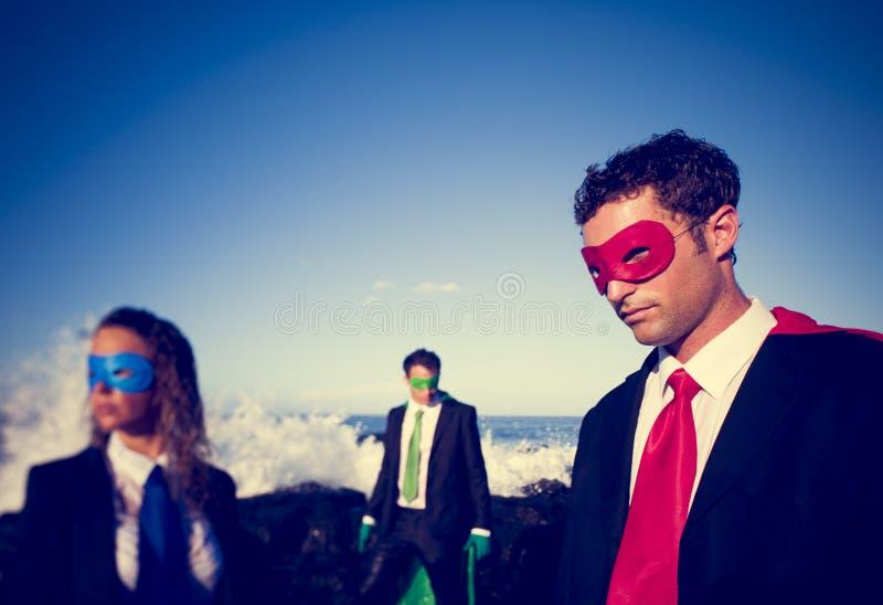 Zaken superheroes op het strand royalty-vrije stock foto's