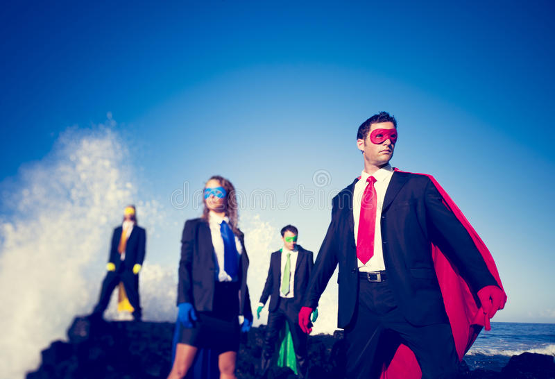 Zaken superheroes op het strand stock foto