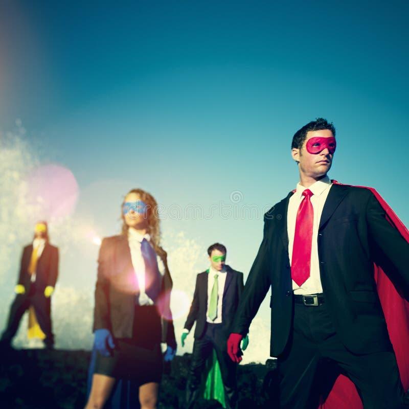Zaken superheroes op het strand zekere concept stock afbeelding