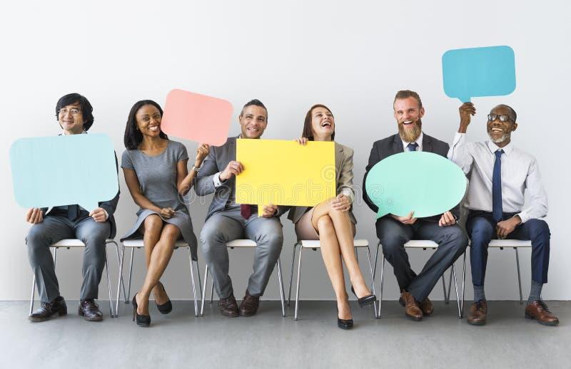 Zaken Team Speech Bubble Holding Concept stock afbeelding