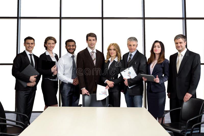 Zakenlieden in de conferentiezaal stock afbeeldingen