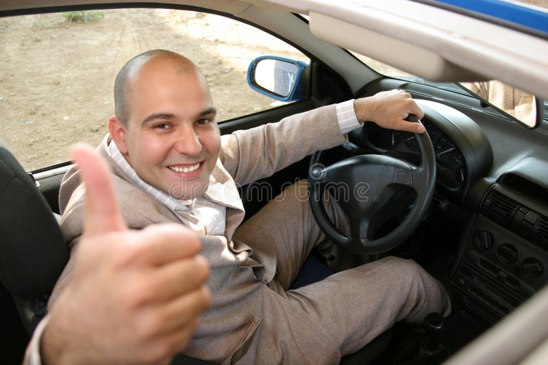Zakenman in de auto stock foto