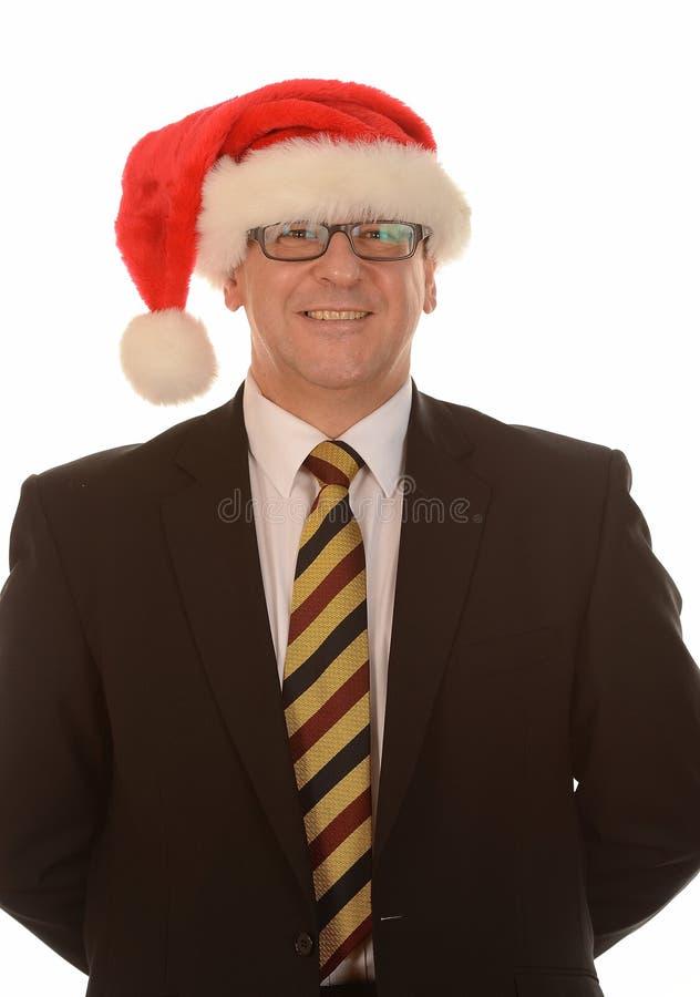 Zakenman in de hoed van de Kerstman stock afbeeldingen