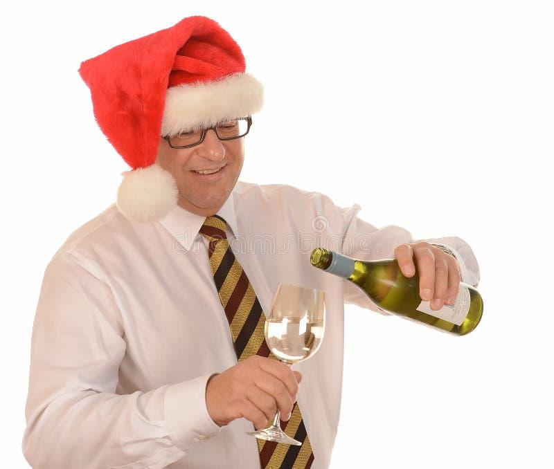 Zakenman in de hoed van de Kerstman stock foto's