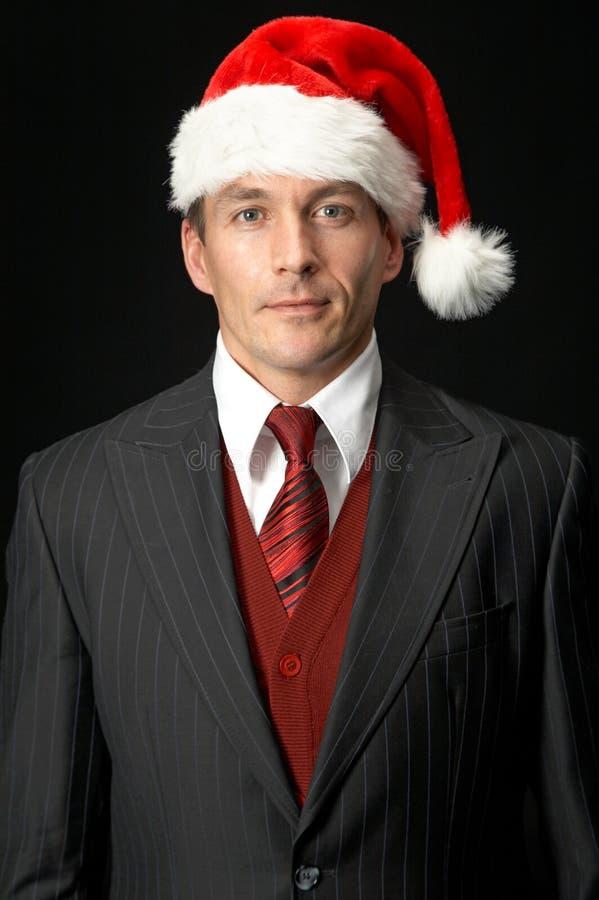 Zakenman in de hoed van de Kerstman royalty-vrije stock fotografie