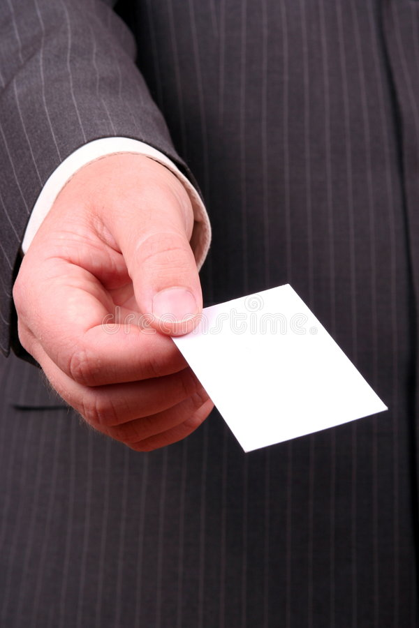Zakenman die adreskaartje aanbiedt royalty-vrije stock foto's