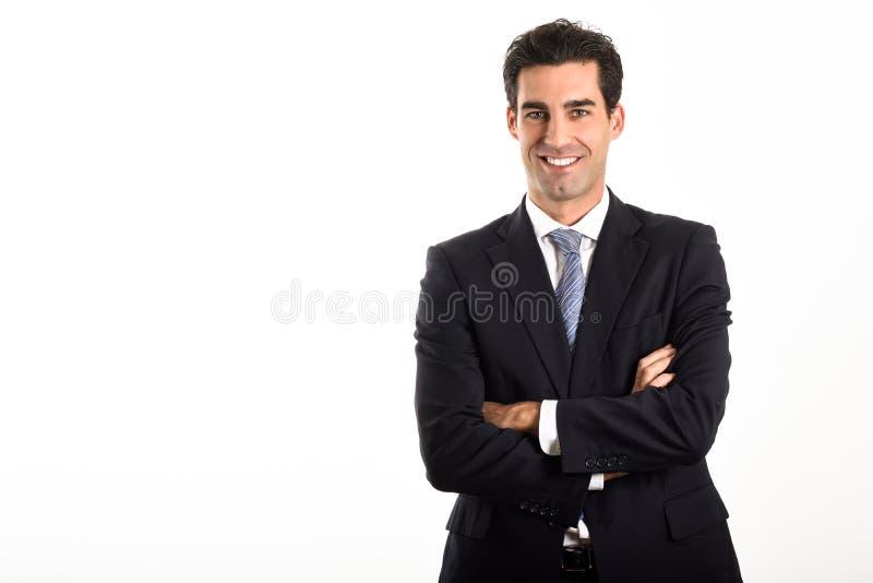 Zakenman die blauwe kostuum en band op witte achtergrond dragen stock fotografie