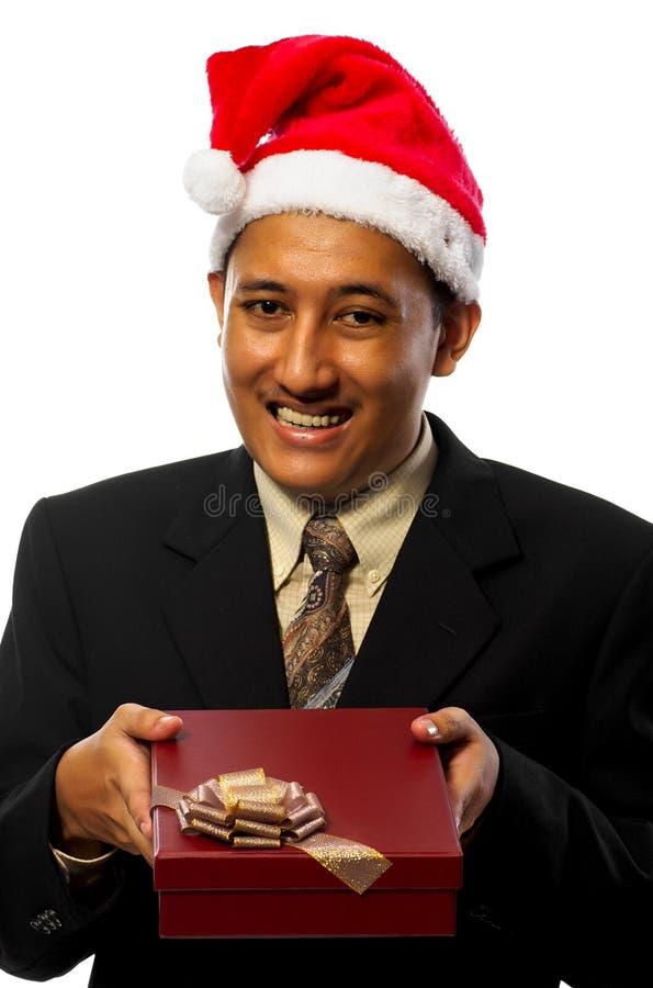 Zakenman die de Hoed die van de Kerstman draagt Heden geeft royalty-vrije stock fotografie