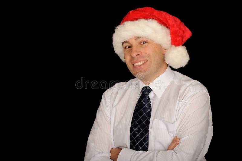 Zakenman die de hoed van de Kerstman draagt royalty-vrije stock fotografie