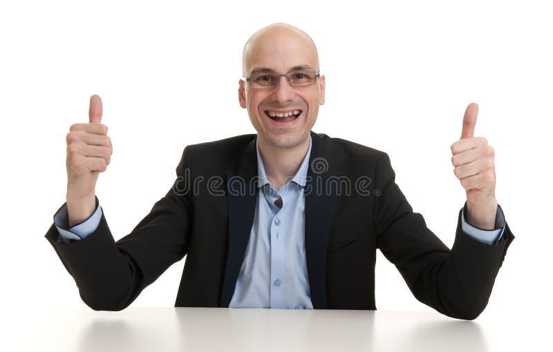 Zakenman die duim op gebaar tonen stock foto