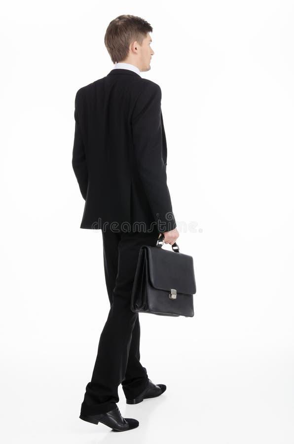 Zakenman die een aktentas dragen stock fotografie
