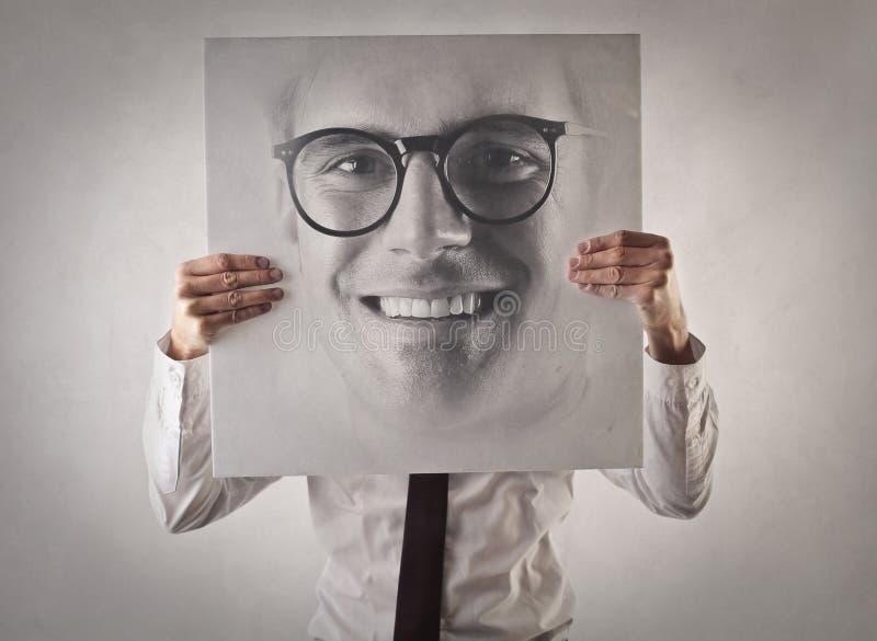 Zakenman die een beeld van zich houden royalty-vrije stock foto's