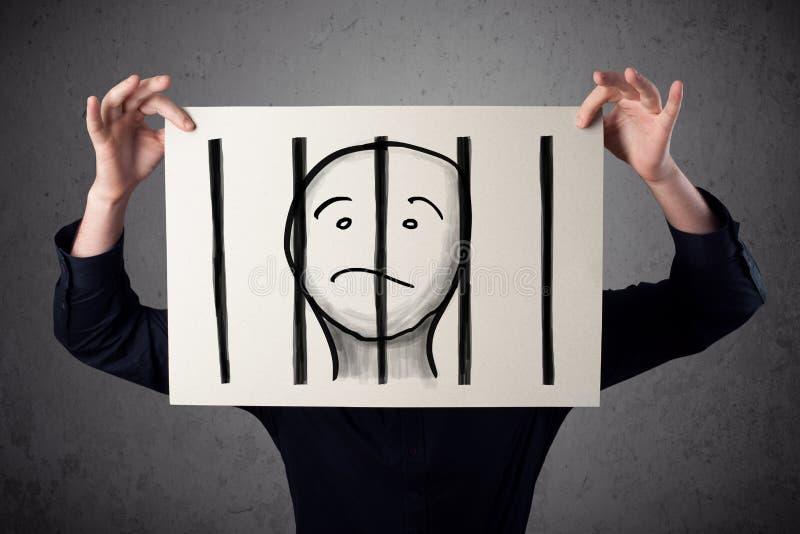 Zakenman die een document met een gevangene achter de bars op I houden royalty-vrije stock afbeeldingen