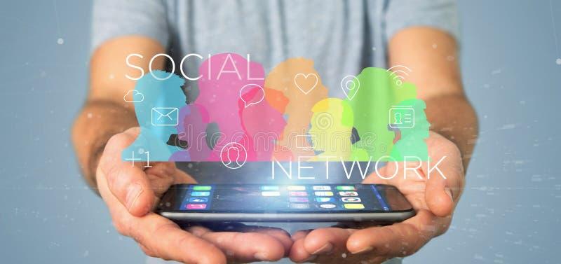 Zakenman die een groepswerk van het colorfull sociaal netwerk met ico houden stock foto's