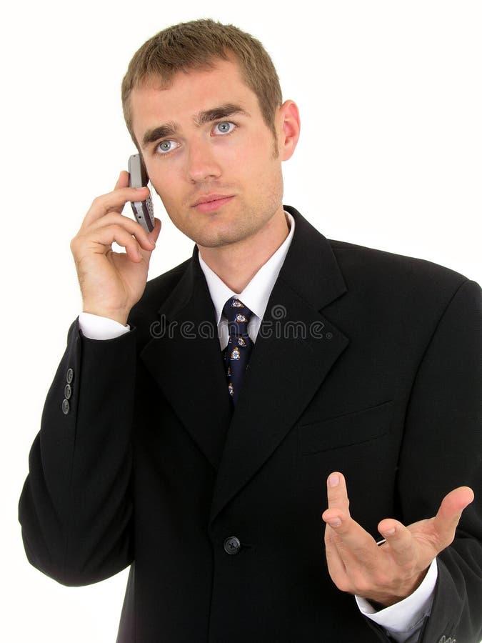 Zakenman die een mobiele telefoon met behulp van stock foto's