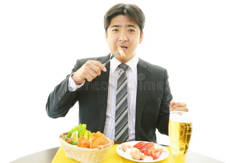 Zakenman die een ontbijt hebben royalty-vrije stock foto
