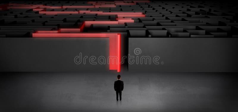 Zakenman die een verklaard donker labyrint beginnen stock fotografie