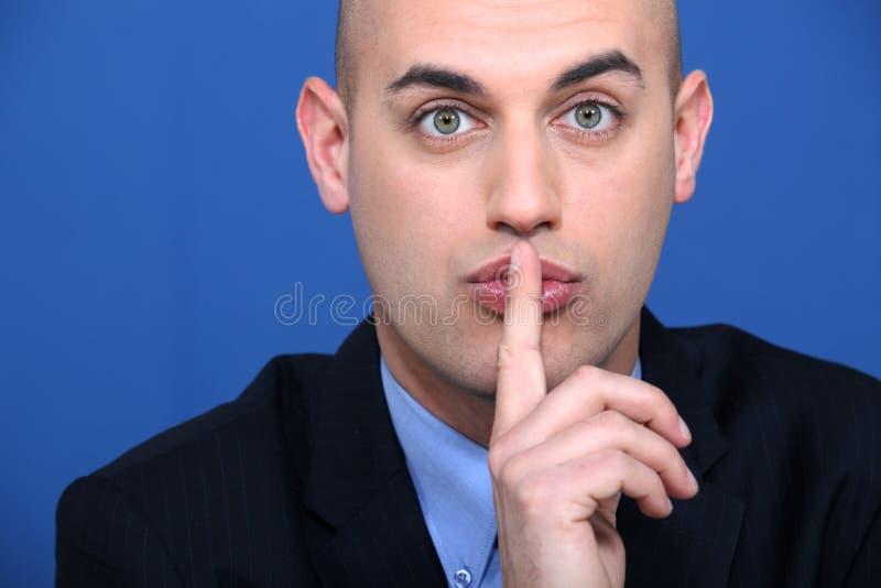 Zakenman die gebaar maken doen zwijgen stock afbeeldingen