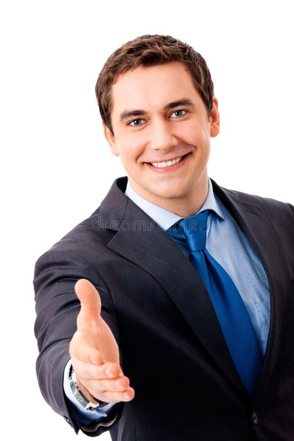 Zakenman die hand voor handdruk geeft stock foto