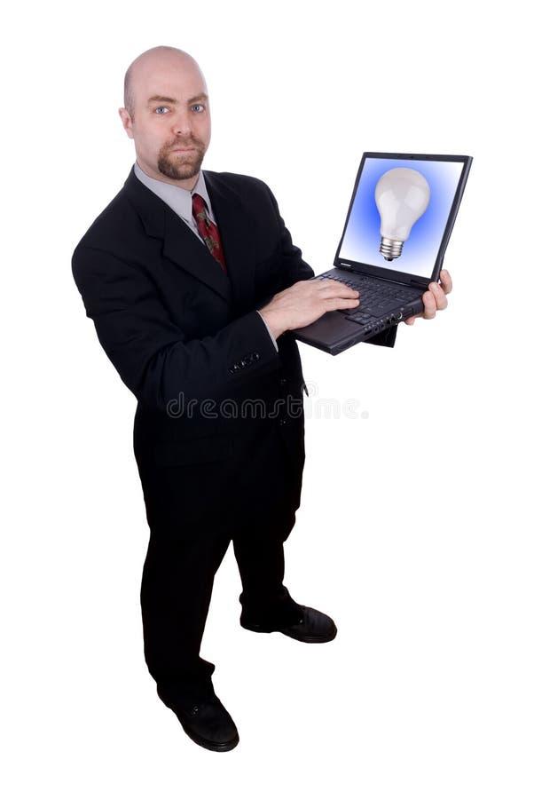 Zakenman die laptop houdt stock foto