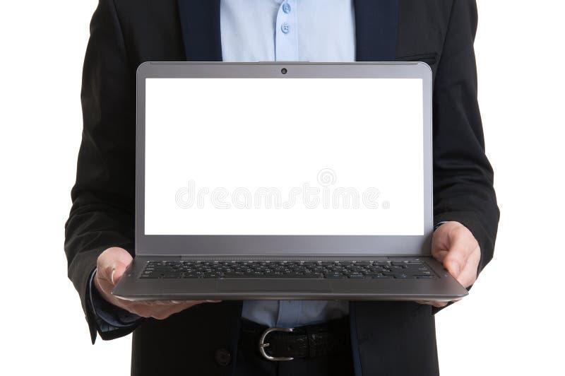 Zakenman die laptop met het lege scherm tonen royalty-vrije stock foto's