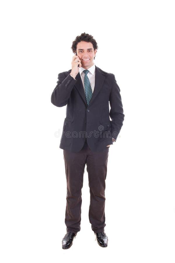 Zakenman die met cel mobiele die telefoon spreken op wit wordt geïsoleerd stock afbeelding