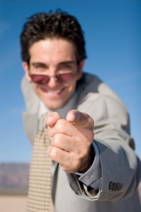 Zakenman die met zijn vinger richt stock foto
