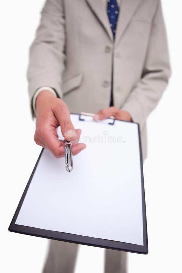 Zakenman die om handtekening vraagt stock fotografie