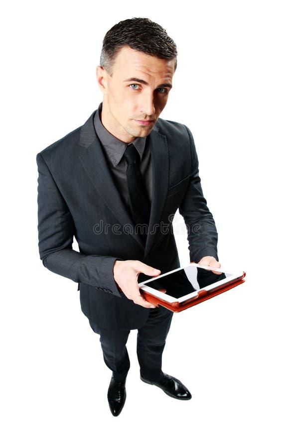 Zakenman die tabletcomputer met behulp van stock foto's