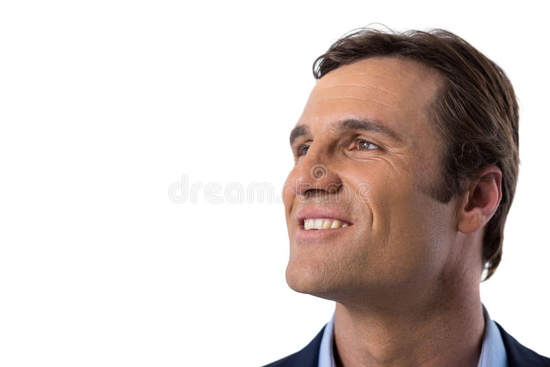 Zakenman die tegen witte achtergrond glimlachen stock fotografie
