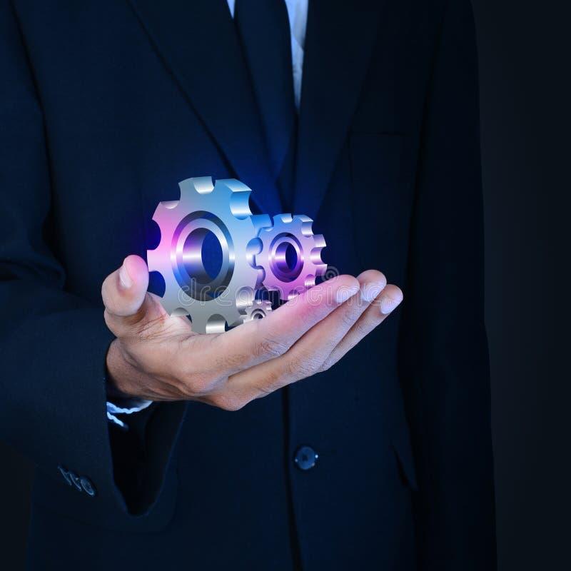 Zakenman die toestellenradertjes tonen aan succesconcept royalty-vrije stock afbeelding