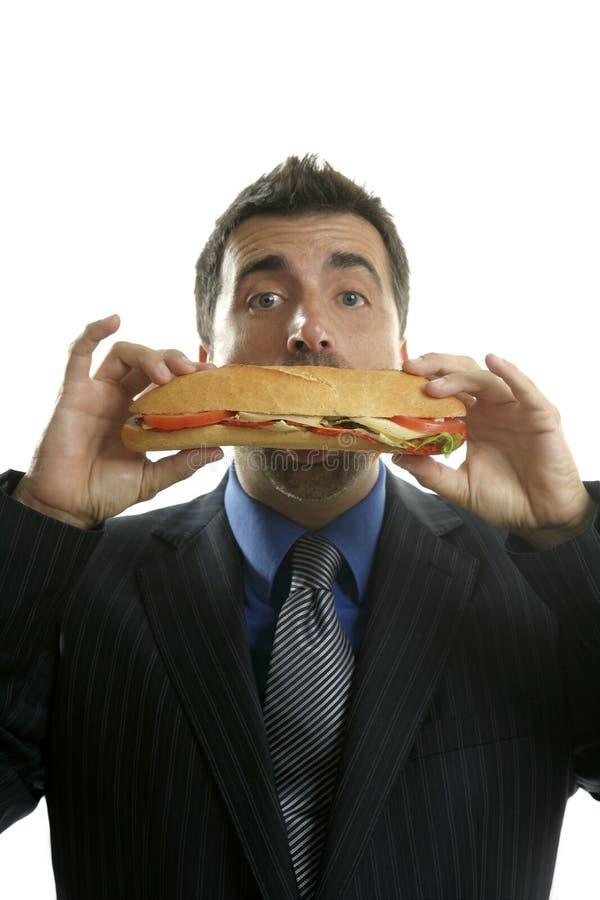 Zakenman die troep snel voedsel eet royalty-vrije stock foto's
