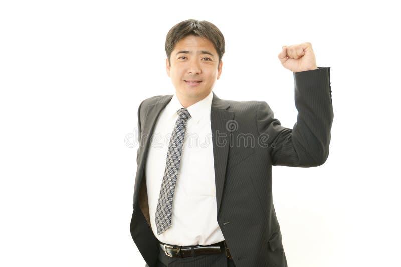 Zakenman die van succes genieten stock foto's