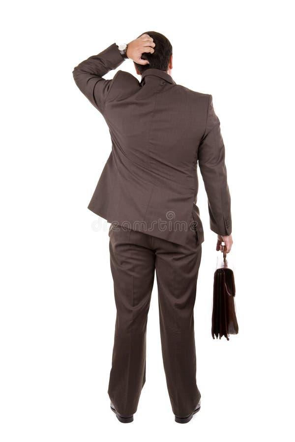 Zakenman die zich met zijn ruggen bevindt stock fotografie