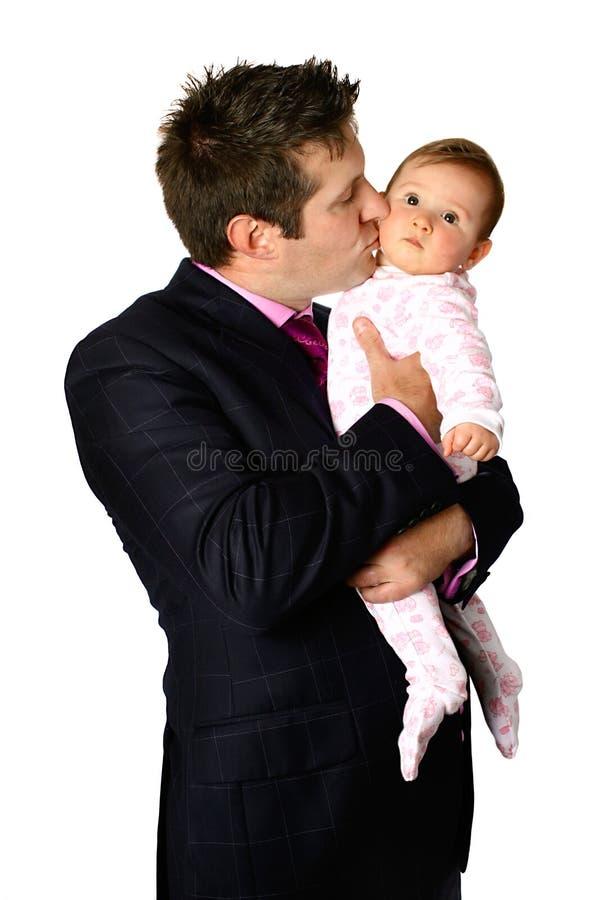 Zakenman die zijn baby kust royalty-vrije stock afbeelding