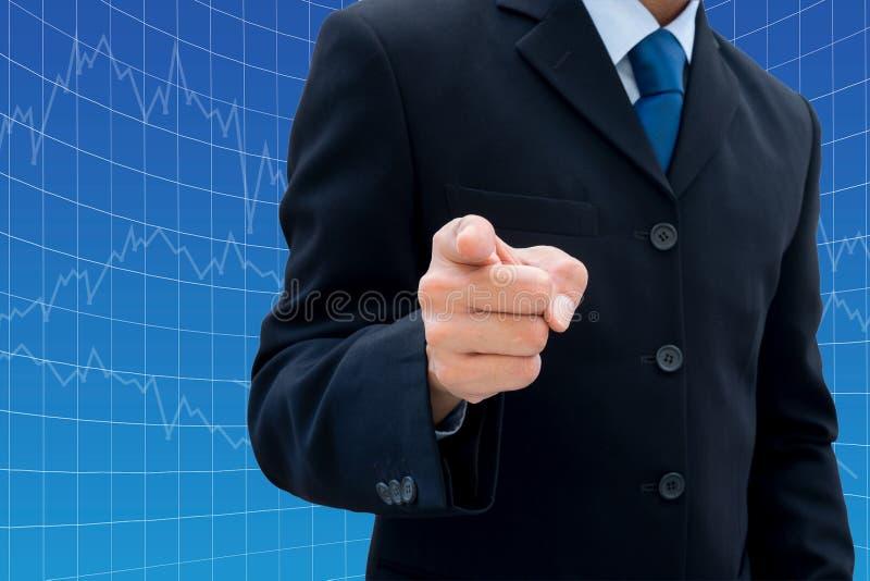 Zakenman die zijn vinger richt stock foto