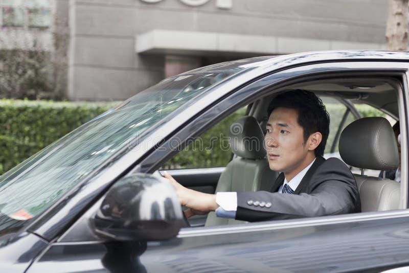 Zakenman Driving Car royalty-vrije stock afbeelding