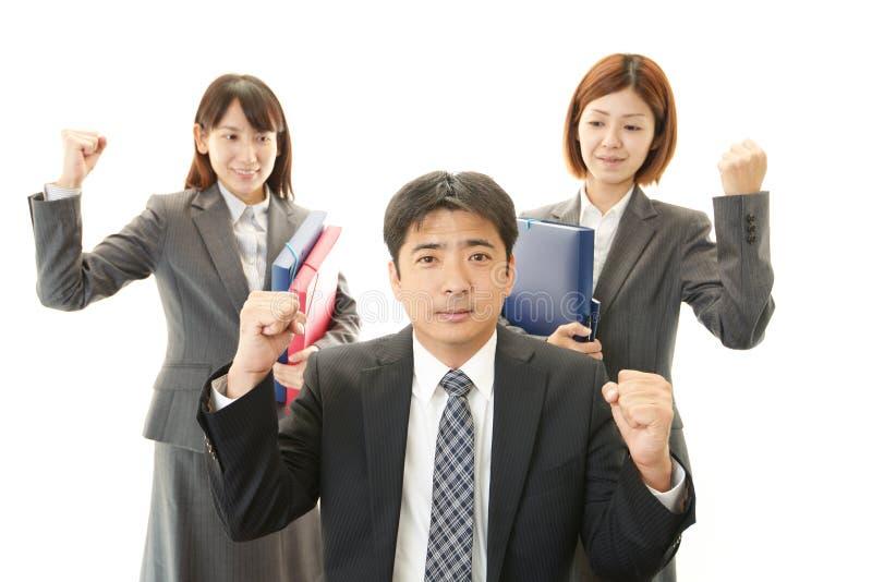 Zakenman en Onderneemsters die van het succes genieten stock foto