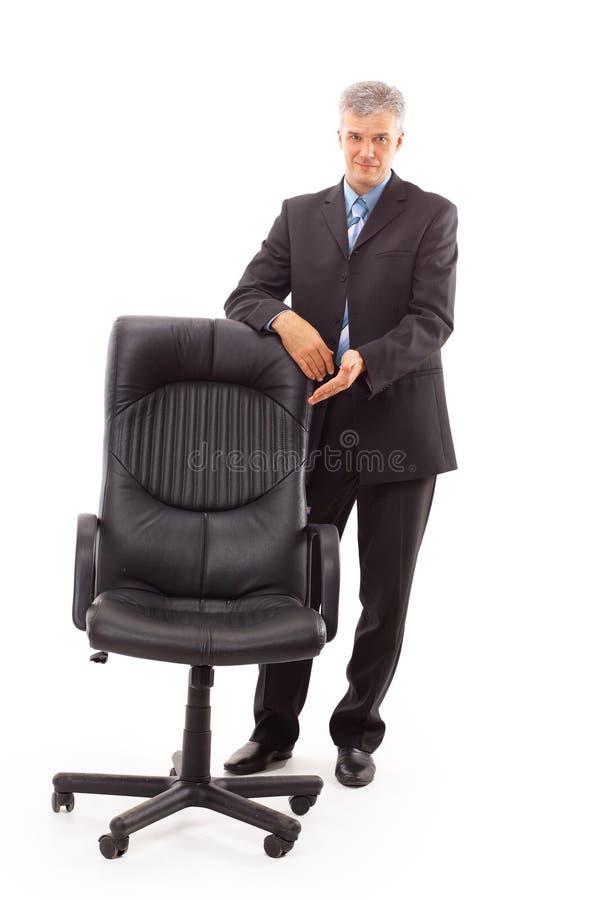 zakenman en stoel royalty-vrije stock foto